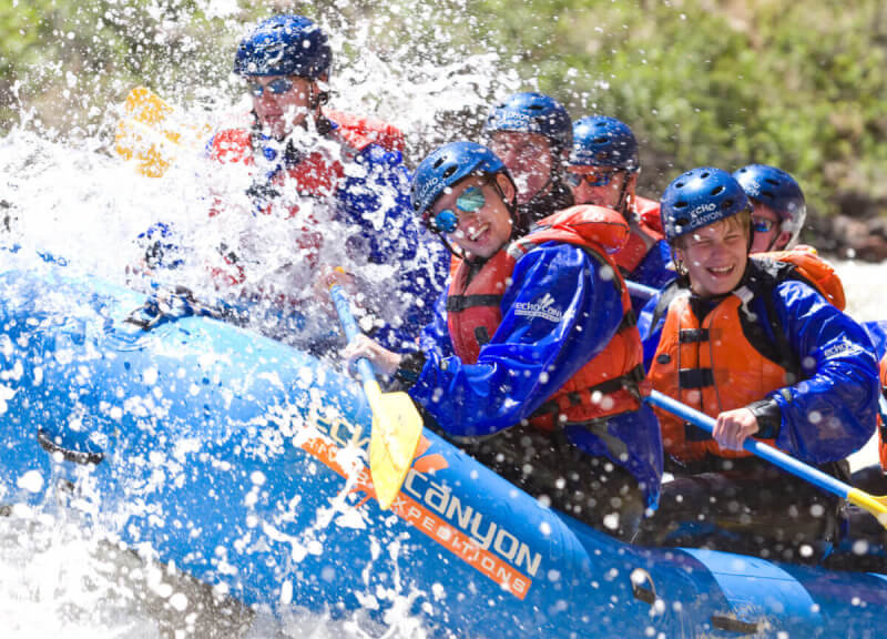 A crew of Echo Canyon rafters get engulfed by a wave in the Royal Gorge.